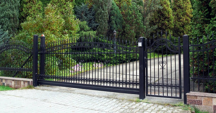 Wrought Iron Fencing Atop Short Brick Fencing